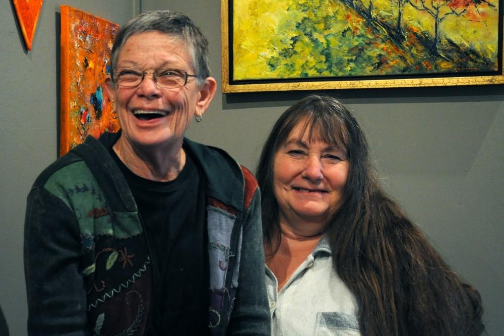 Erin Wells (left) and Debra Simpson (right) banter as they enjoy the current art hung up on the gallery located on orange street.Photo credit: Annie Paige