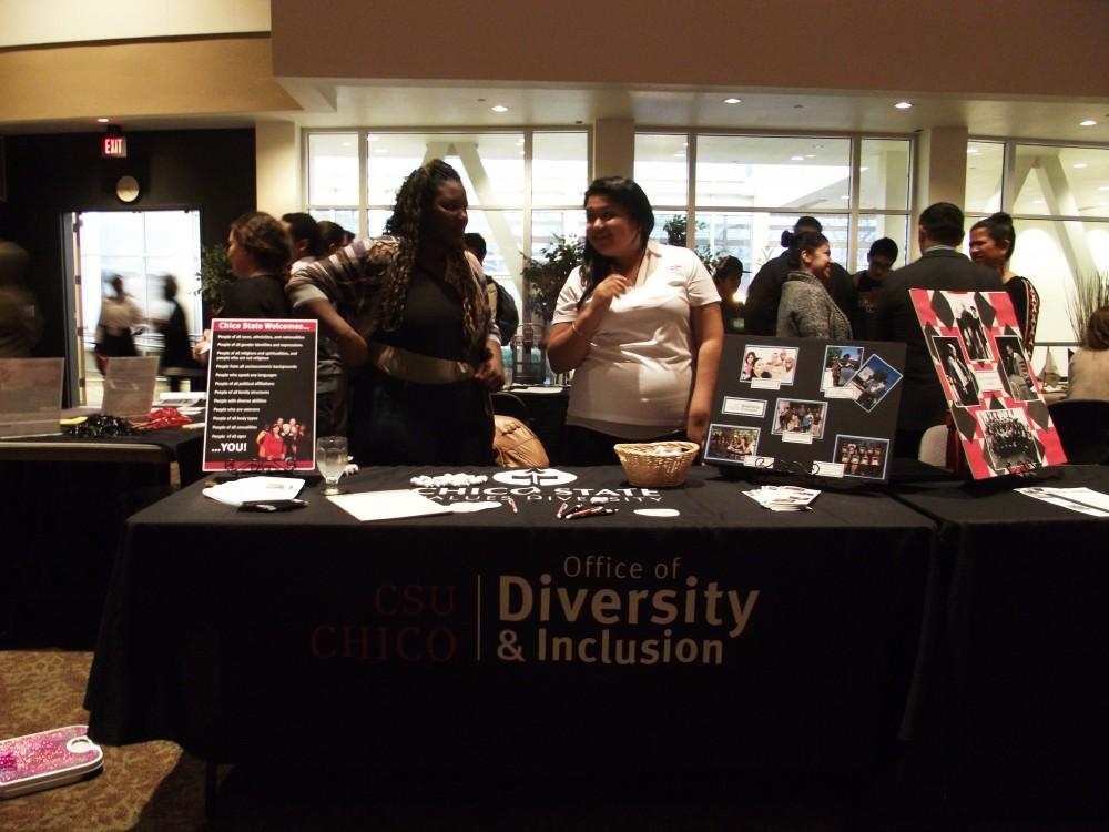 Fabiola Paniagua, senior  recreational therapy student, and Desiree Stevens, junior sociology major, are working at the Office of Diversity and Inclusion table at the Cultural Collaboration Reception.Photo credit: Frances Mansour