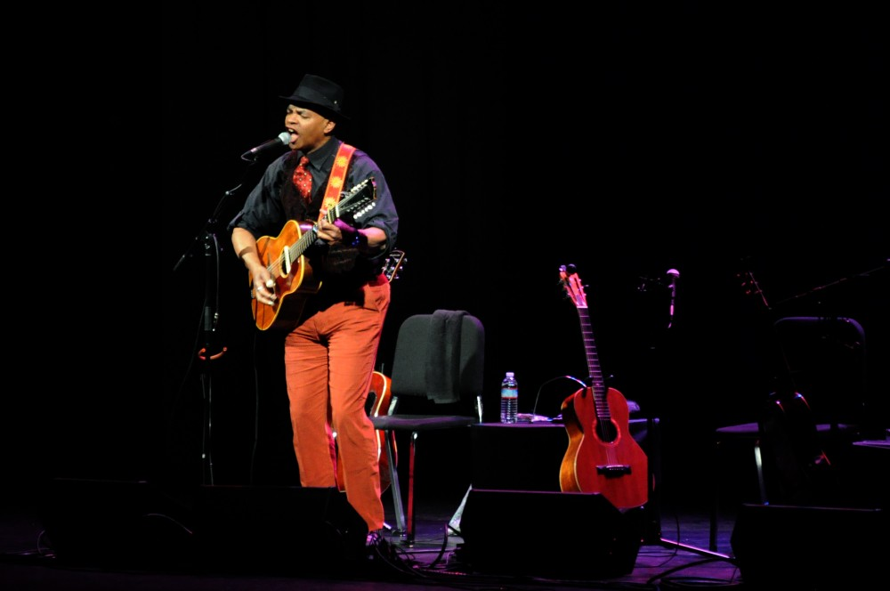 Guy Davis, one of the three blues performers of the night, belts out a soulful song to start off the night filled with foot-tapping and audience-participate howling. Photo credit: Annie Paige