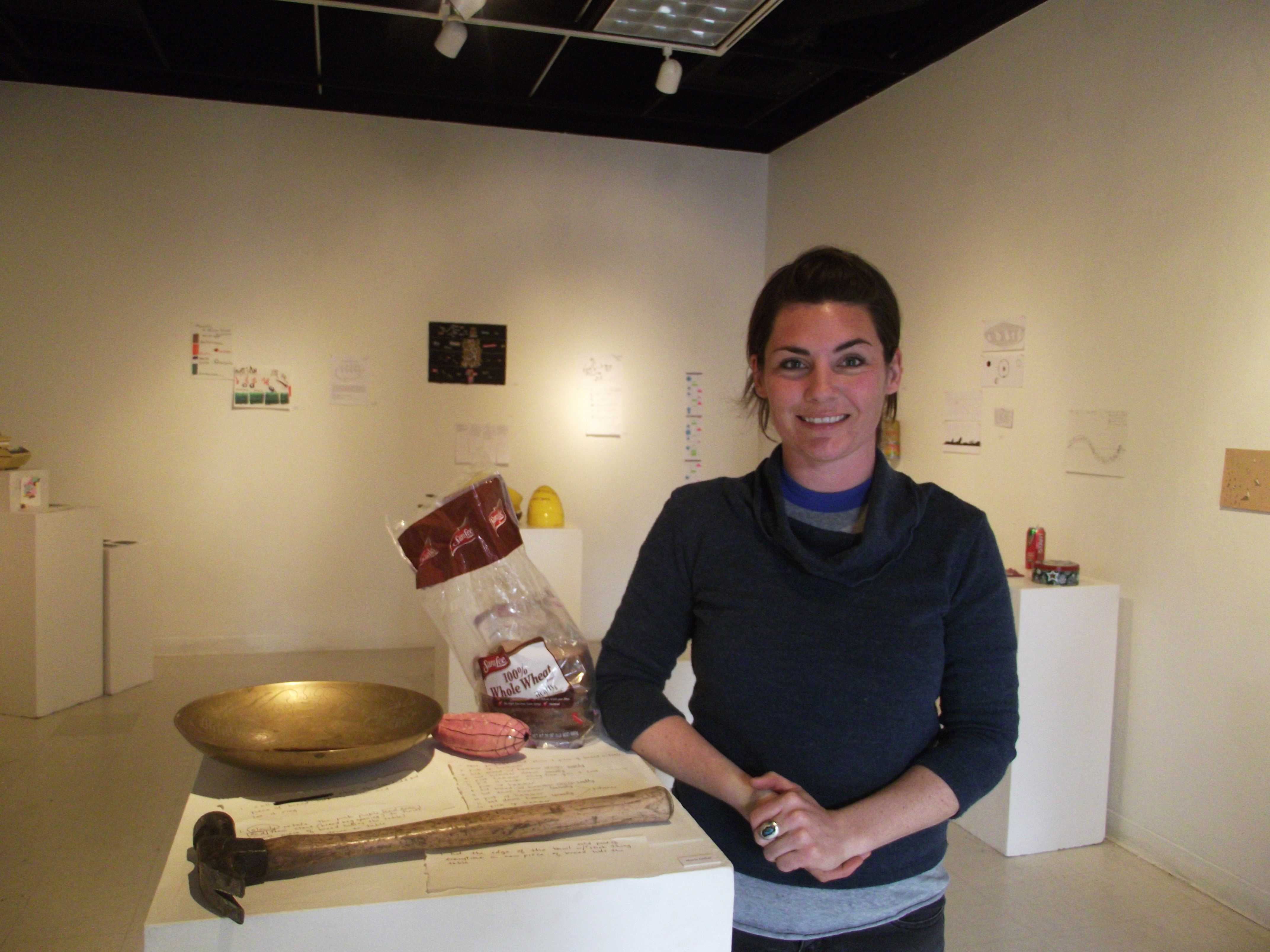 Marie Collor, a senior fine art and sculpture major, is standing next to her installment for the