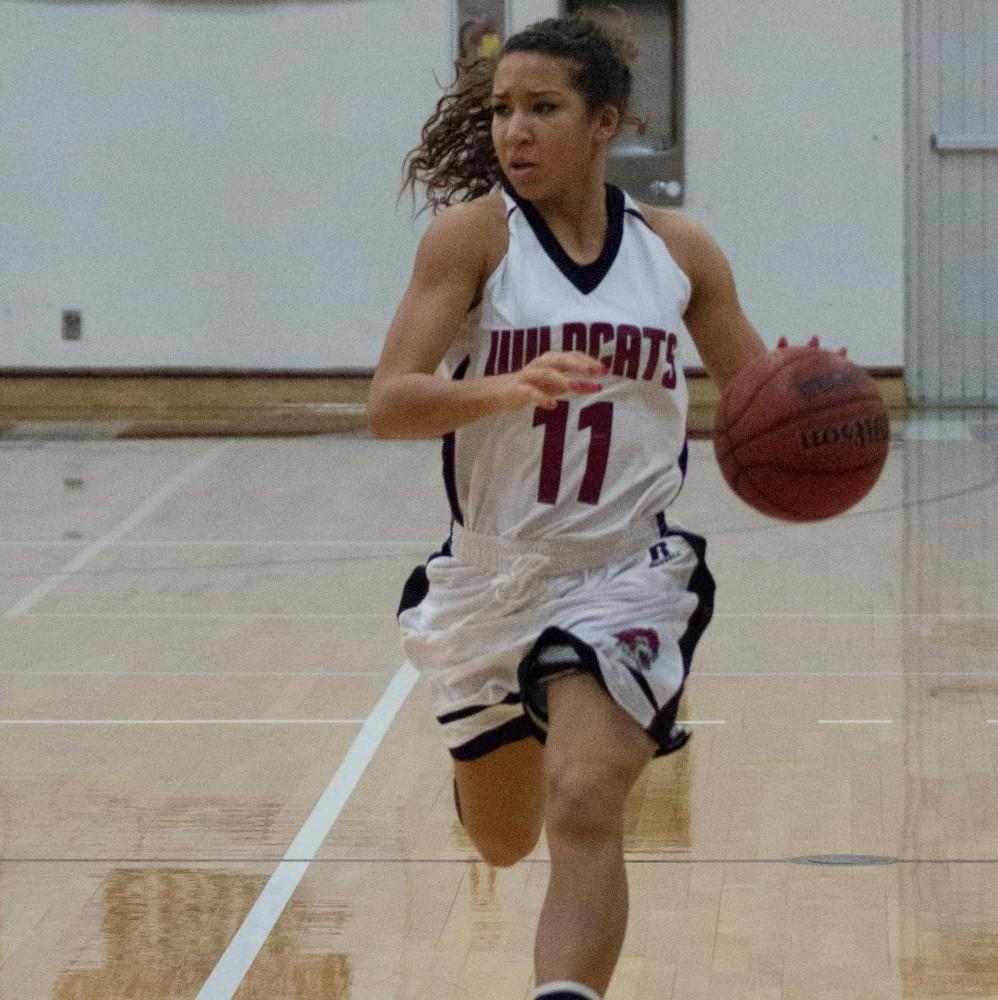 Junior guard Hannah Womack takes the ball up court during a game earlier this season.