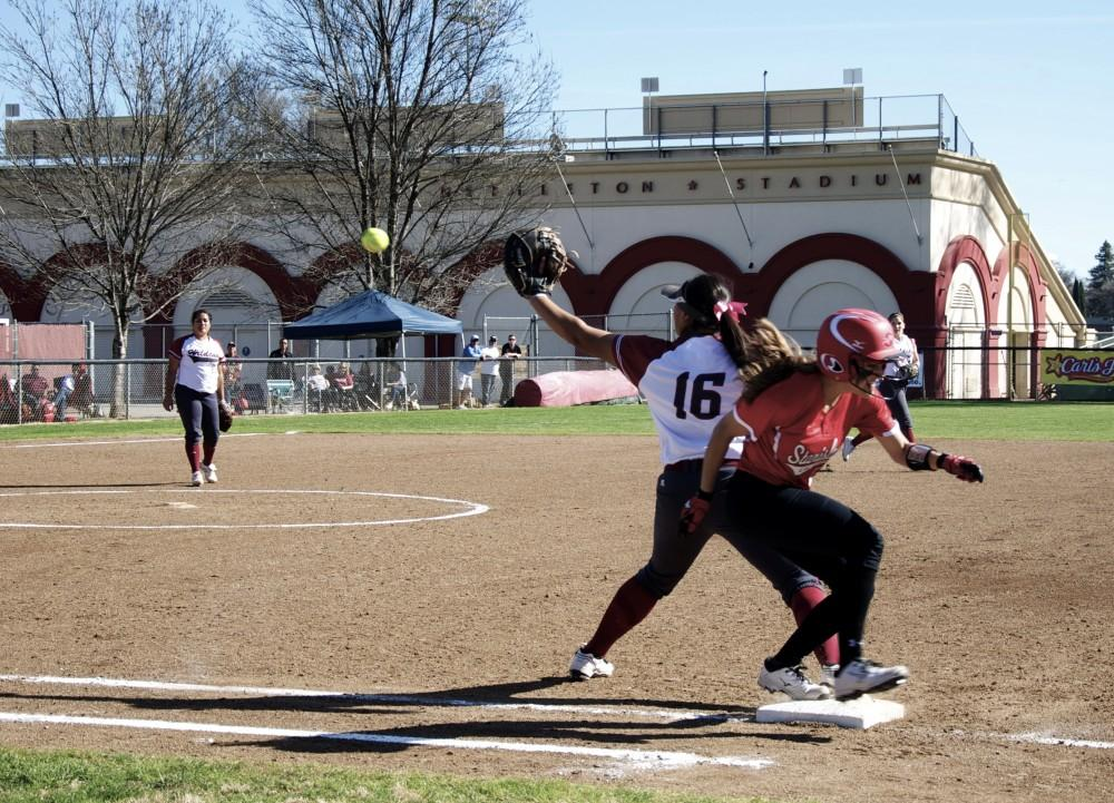 First baseman Desiree Gonzales tries to make a play at first Friday against Cal State Stanislaus.Photo credit: Annie Paige