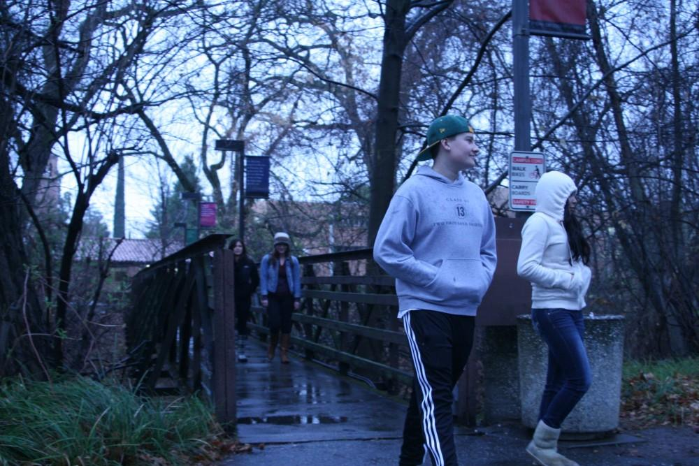 Freshman Jake Floriolli, a physiology major, and freshman Viviana Ayala, a nursing major, cross the bridge between Butte and Holt hall.Photo credit: Madison Holmes