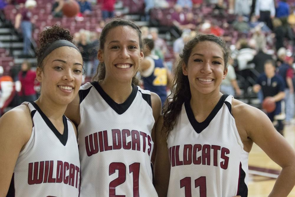 Seniors Jazmine Miller and Courtney Hamilton and junior Hannah Womack, guards, are all smiles after beating UC San Diego on Friday.Photo credit: Grant Mahan
