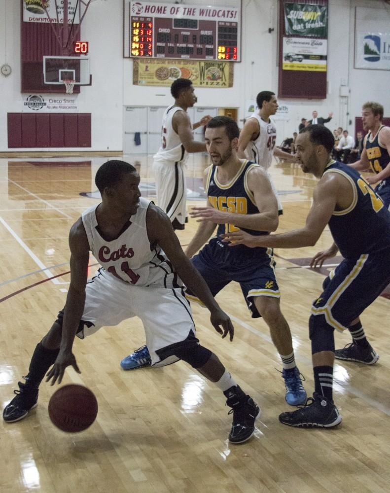 Rashad Parker looks to make a pass, while being double guarded.Photo credit: Grant Mahan