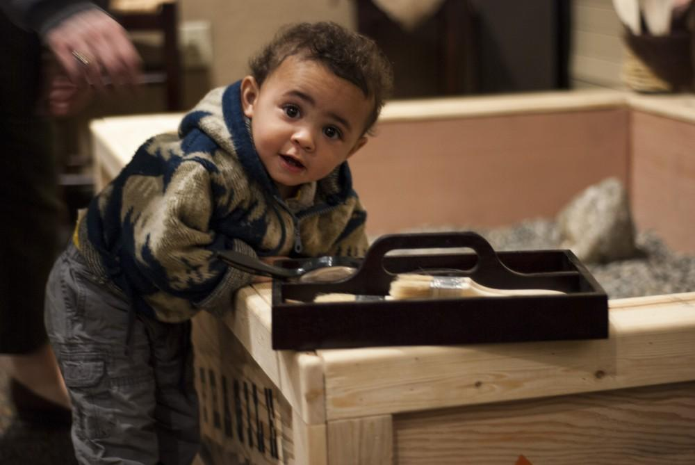Desmond Weatherby explores the excavation box during his visit to the Gateway Science Museum.Photo credit: Alex Boesch