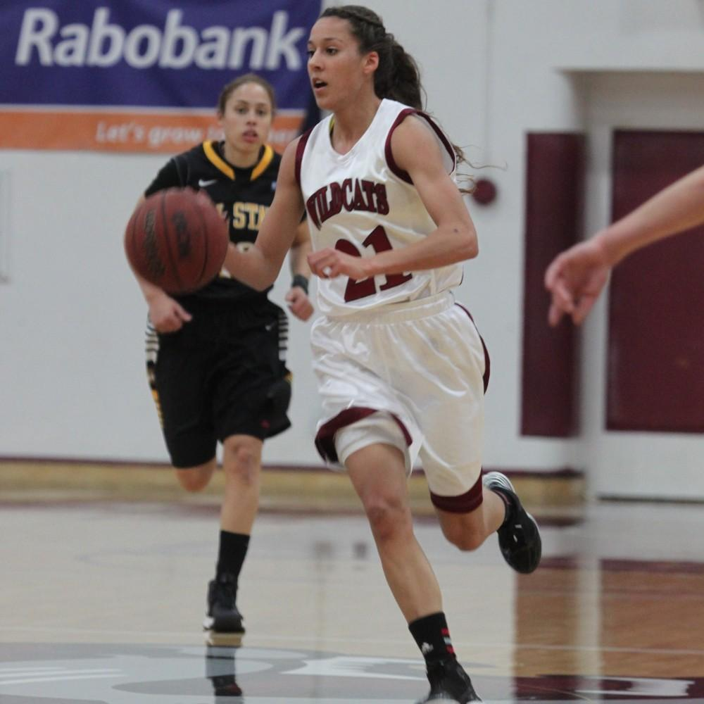 Guard Courtney Hamilton takes the ball up the court during a game earlier this season.