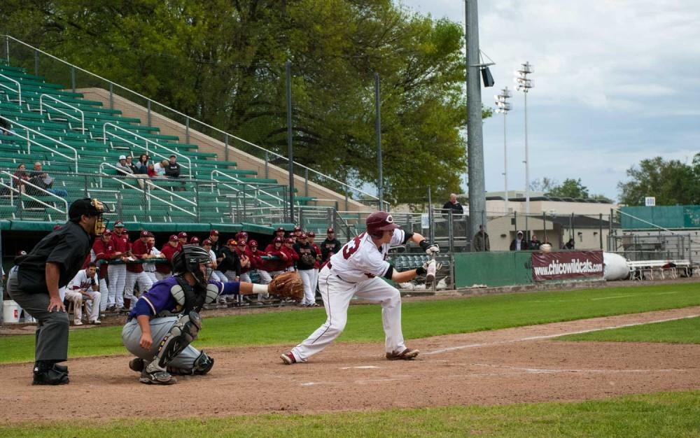 The Wildcats call for a bunt to attempt to advance the runners.  Chico state battled San Francisco State in a doubleheader Friday. Photo credit: Alex Boesch
