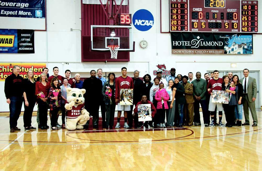 The senior players of the Chico State basketball team line up with their families and are recognized for their accomplishments on the team.Photo credit: Annie Paige