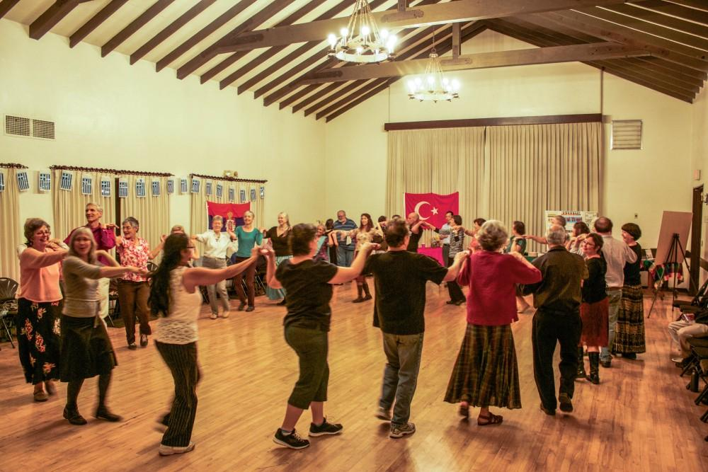 People come together at the Chico Womens Club on Friday night for international folk dancing. Photo credit: Chelsea Jeffers