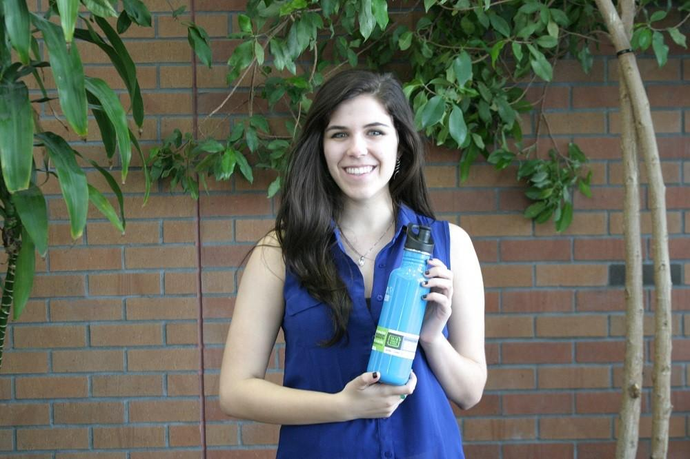 Sheridan Ex poses with her raffle prize from the This Way to Sustainability Conference. Photo credit: Shannon Miller
