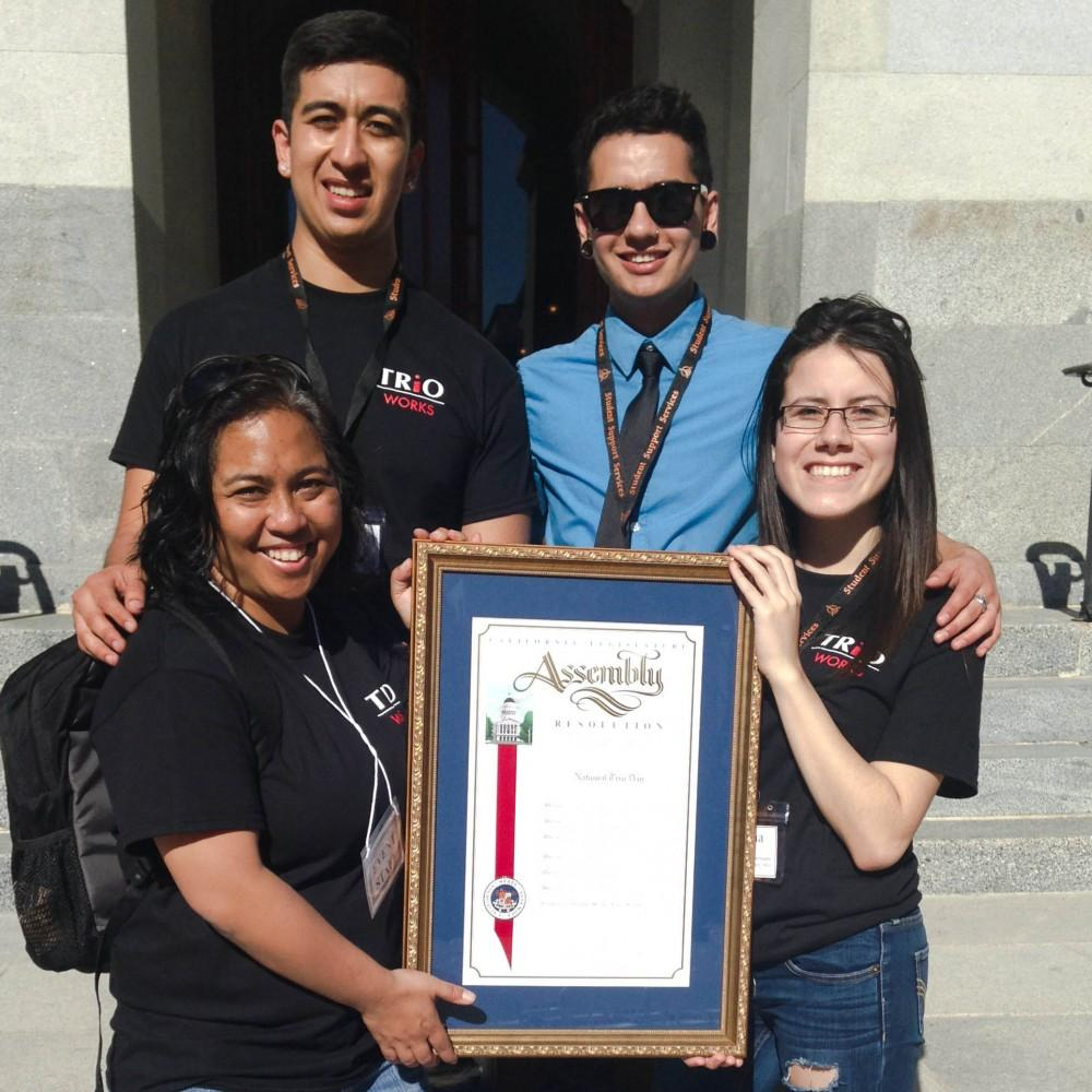 Rico Ramirez, Kory Masen, Caren Fernandez and Paulina Belmontes celebrate National TRiO Day Feb. 21 in Sacramento with an assembly plaque.Photo credit: Prin Mayowa