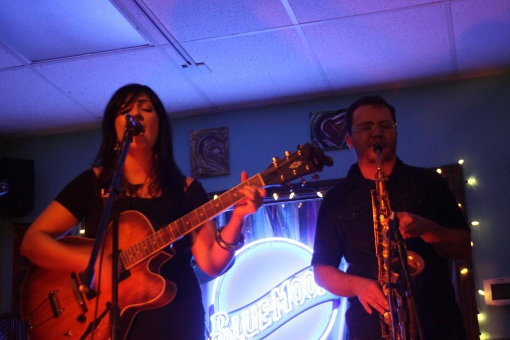 Lisa Valentine singing her lungs out with Saxophonist playing at Cafe Flo Friday night. Other musicians included trumpet, base, piano and drums. Photo credit: Shayla Ramos