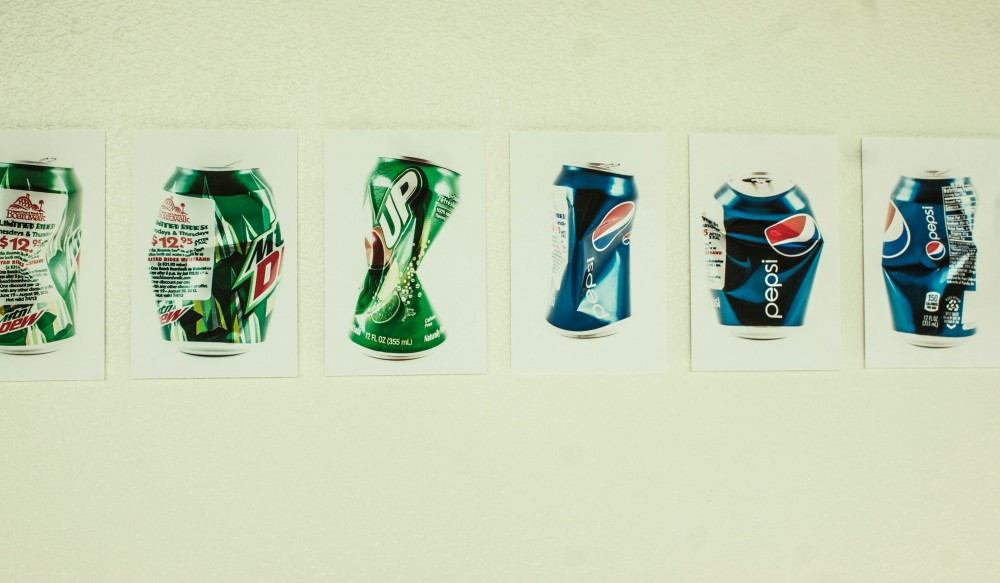 Ryan Voigtman's Mountain Dew and Pepsi cans in his exhibition on the third floor of the BMU. Photo credit: Chelsea Jeffers