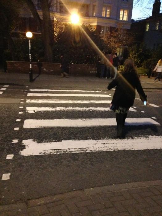 Michelle Manera walks the famous Abbey Road crossing. Courtesy of Michelle Manera.