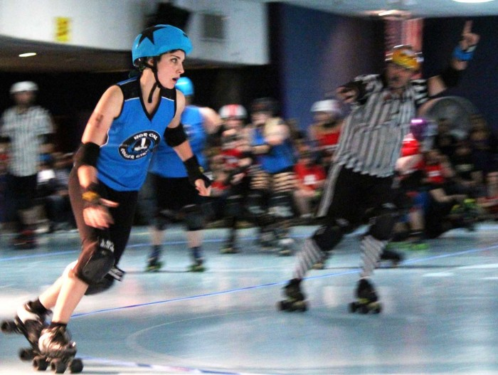Sarena Kirk, a senior sociology and women's studies major, speeds around the rink for the Nor Cal Roller Girls. Photo credit: Quinn Western.