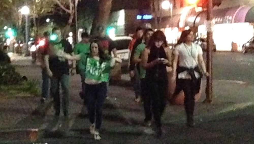 Party-goers walking downtown on evening of St. Patrick's Day in Chico. Photo credit: Christine Lee