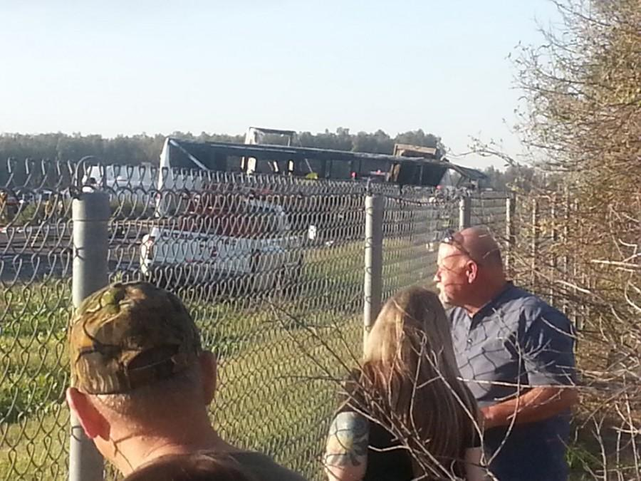 Orland residents look on Thursday as emergency personnel clean up the accident. Photo credit: Sharon Martin