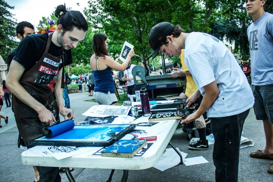 Max Valentine and Hayden Senter, both art majors, making prints for the Thursday Night Market attendees. Photo credit: Chelsea Jeffers