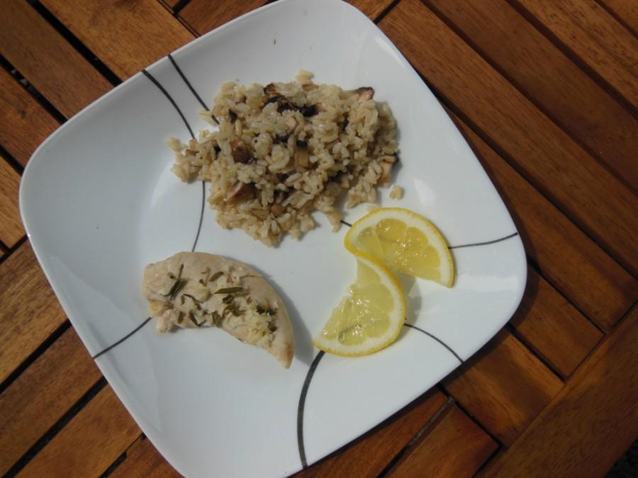 Baked rosemary chicken with mushroom rice can bring a little zest to an evening. Photo credit: Christina Saschin