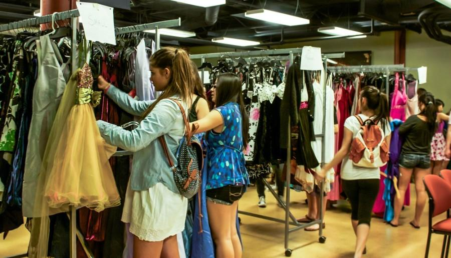 High school students search for the perfect prom dress at Cinderella's Closet. Photo credit: Chelsea Jeffers