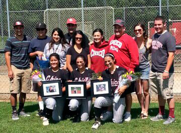 From left to right, Alex Molina, Scotie Walker and Kayla Barber with their families behind them on Senior Day. Photo credit: Emerson Keenan