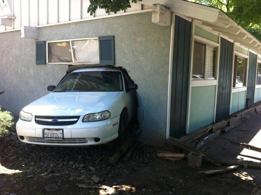 The white vehicle reversed into the home and was halfway through the bedroom. Photo credit: Yessenia Funes