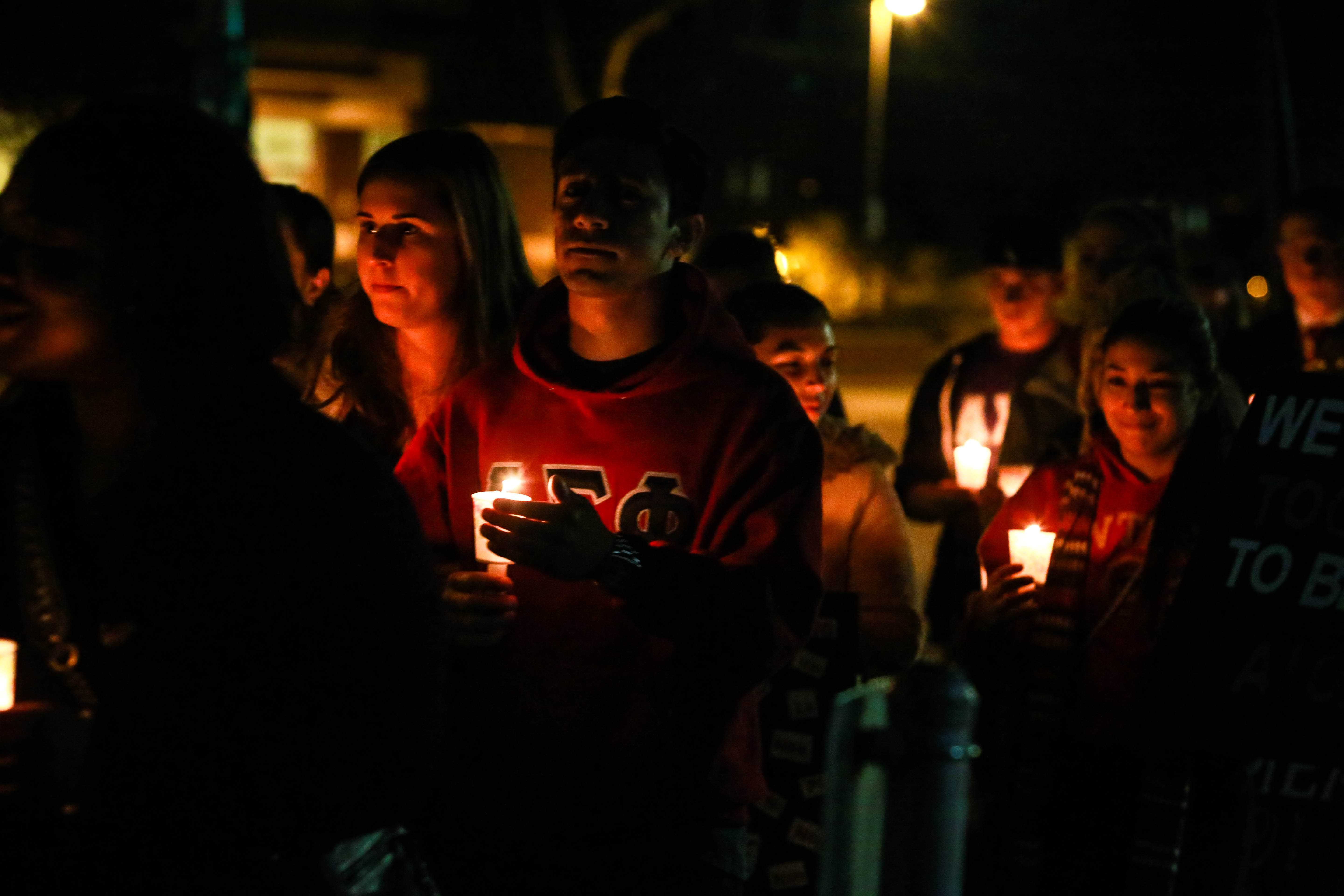 Students march from campus to the streets for Take Back the Night Thursday evening with candles. Photo credit: Emily Teague