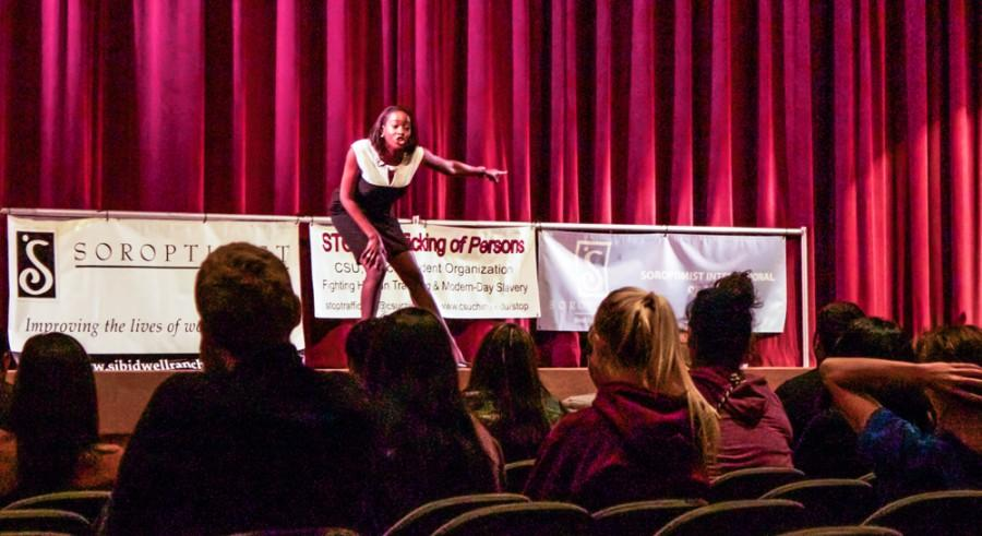 Shamere McKenzie, a survivor of human trafficking, urges students to make a change, to try to stop human trafficking. Photo credit: Chelsea Jeffers