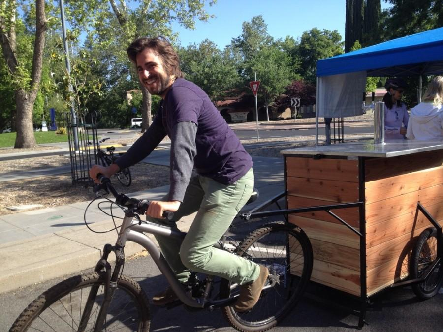 Joey Haney, Chico Natural Foods Cooperative ownership and outreach coordinator, rode the kombucha cart at the Walk and Roll Wednesdays event. Photo credit: Amanda Hovik