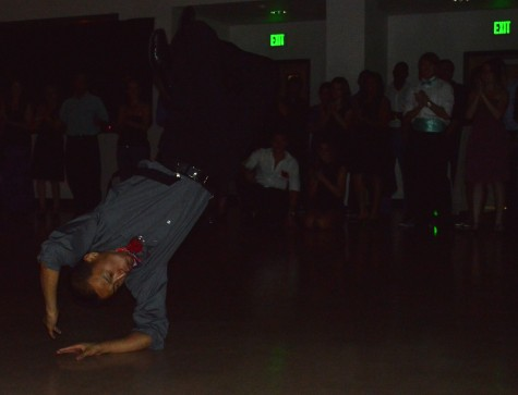 A break dancer backflips to victory at PETE's annual prom night while the audience watches. Photo credit: Veronica Hodur
