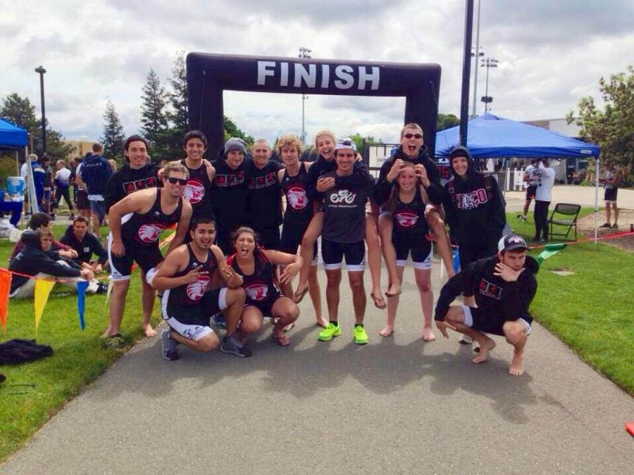 The Chico State triathlon club poses at the finish line after a competition last year. Photo courtesy Nick Brugioni.