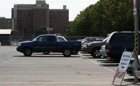 Empty dorm parking spots at the lot on Warner Street and West Sacramento Avenue. Photo credit: John Domogma