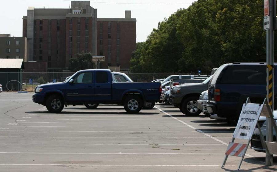 Empty dorm parking spots at the lot on Warner Street and West Sacramento Avenue. Photo credit: John Domogma