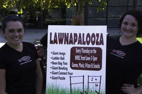 Diana Hass, left, and Athena Oreck, right, stand outside the WREC on Thursday for the first Lawnapalooza event. Photo credit: Brandon Foster