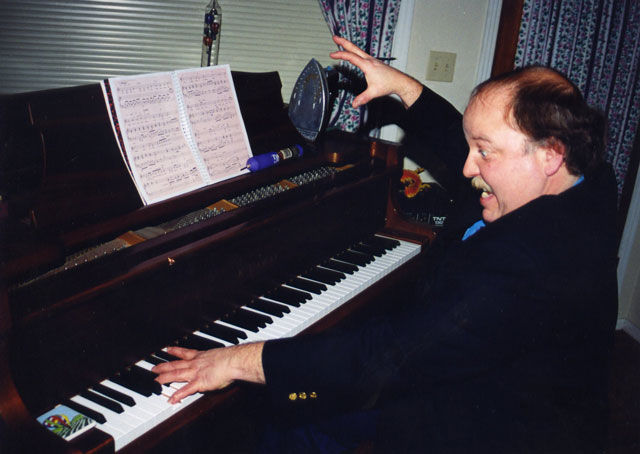 Pianist Roland Allen will sing and play original comedy songs for