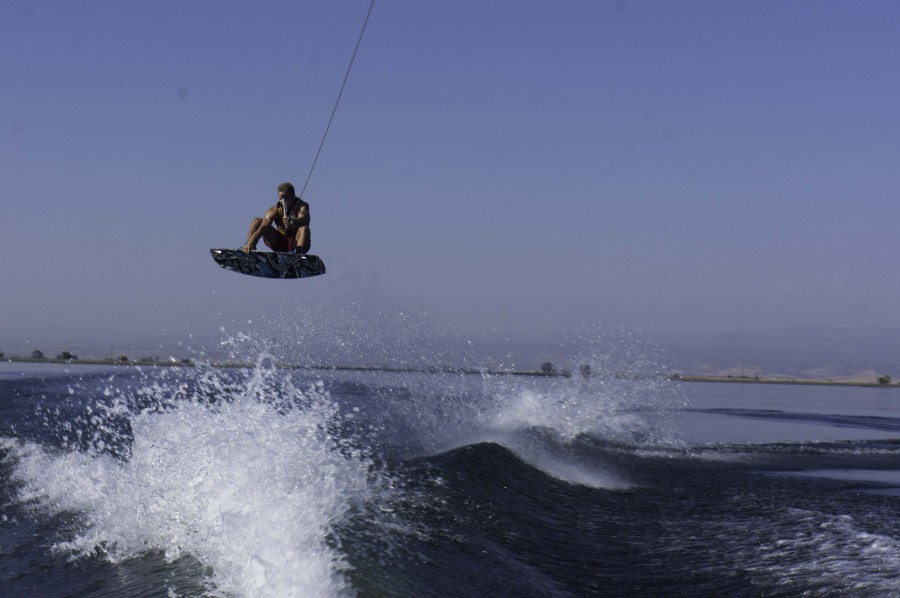 Chico State wakeboarder Colton Duncan sails through the air and over the wake in practice. Photo credit: Brandon Foster