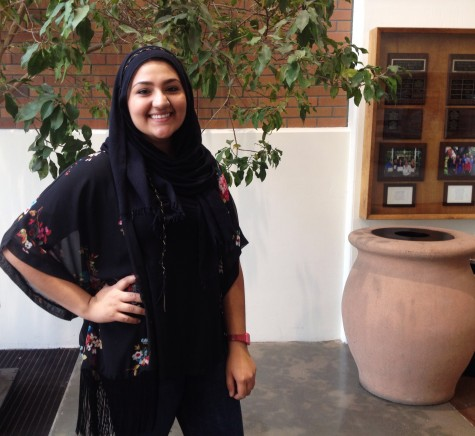 Aroosa Khan, junior criminal justice major, likes to mix contemporary fashion with her headscarf. Photo credit: Michaela Sundholm