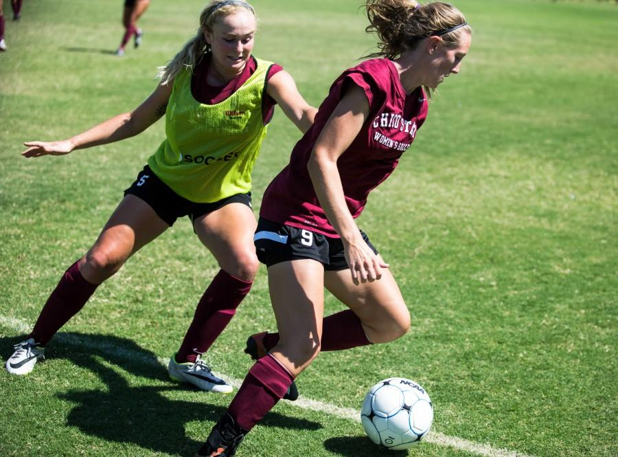 Katie Woodrum, left, and Katie Brown, right, battle for the ball in practice earlier in the season. Brown assisted one of Megan Tablers goals in Chico States 2-0 win over Dominican on Friday. Photo credit: Emily Teague