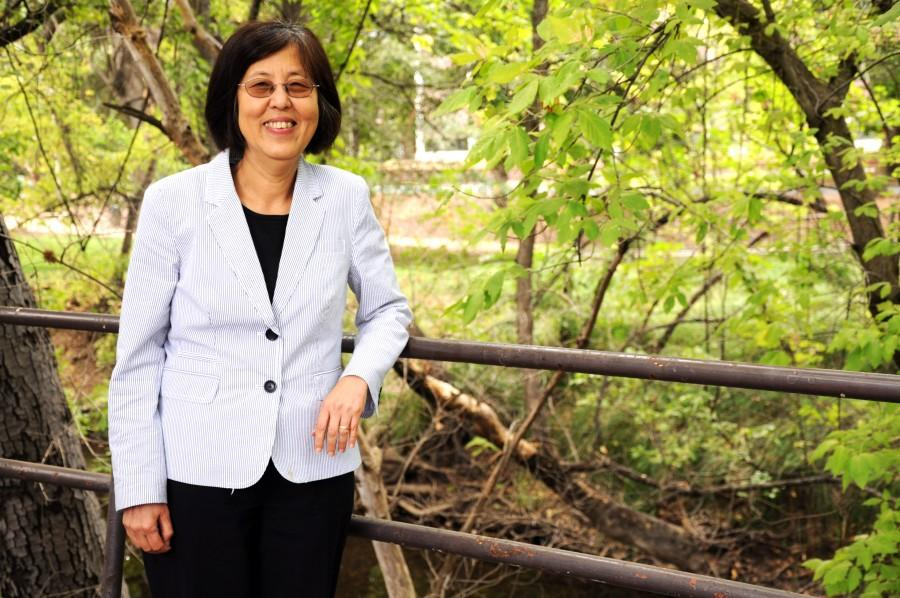 Belle Wei, Chico State's provost, stands next to her favorite place on campus, Little Chico Creek by Selvester's Cafe-by-the-Creek, where she often met for staff meetings. Photo credit: Annie Paige