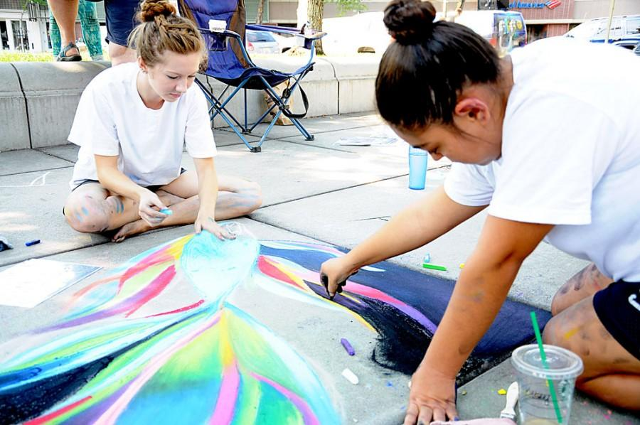 Butte College students Kelsey Wade, left, and Daryll Venegas, right, enjoy their 5th and 4th years at the Pastels on the Plaza event on Saturday from 9 a.m. to 2 p.m. at the Chico City Plaza. Photo credit: Annie Paige
