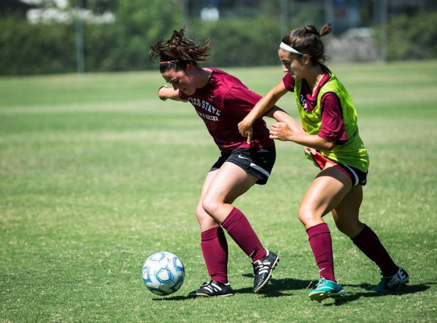 Chico State soccer player Courtney Sharrah battles with a teammate in practice. The Wildcats fell 2-0 to Cal Baptist on Saturday. Photo credit: Emily Teague