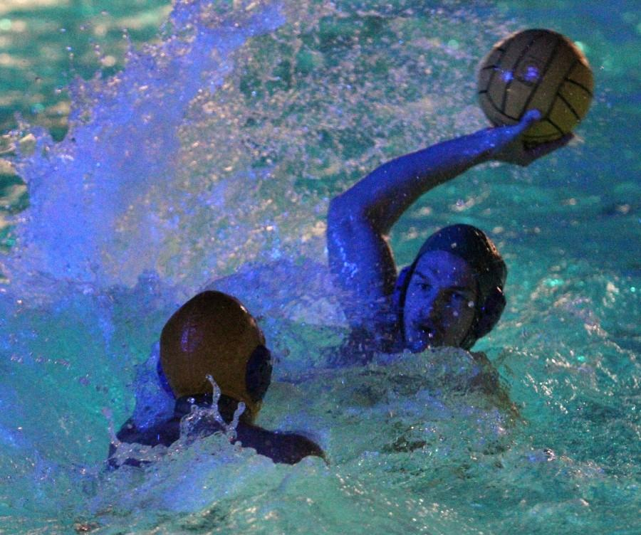 Chico State's water polo club player Misha Sinkevich takes a shot last season. The club, founded in 1985, is hoping for its first championship this year. Orion file photo. Photo credit: Veronica Hodur