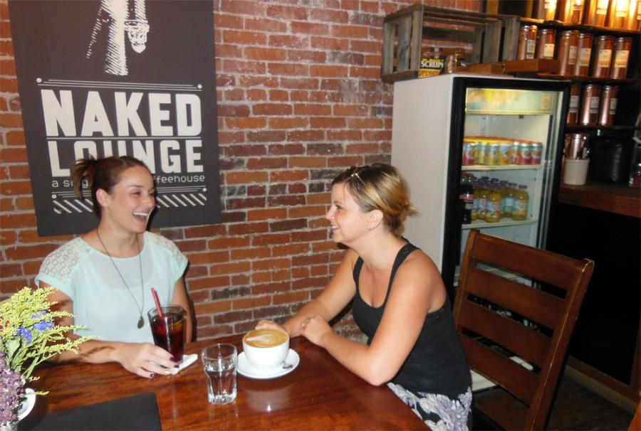 Chico State alumnae Melissa Oji and Samantha Fernandez, catch up over coffee at Naked Lounge. Photo credit: Christina Saschin