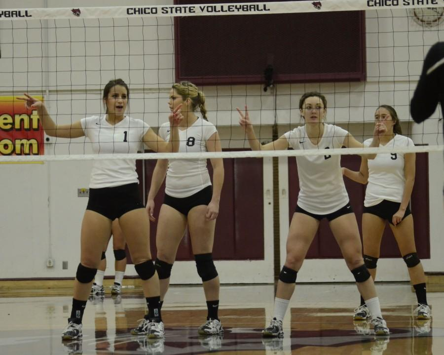 Junior middle hitter Kristyn Casalino, left, sophomore outside hitter Shannon Boling, left center, junior outside hitter Ellie Larronde, right center, and freshman middle hitter Anuhea Kaiaokamalie prepare for a serve in a game last year. Orion File photo