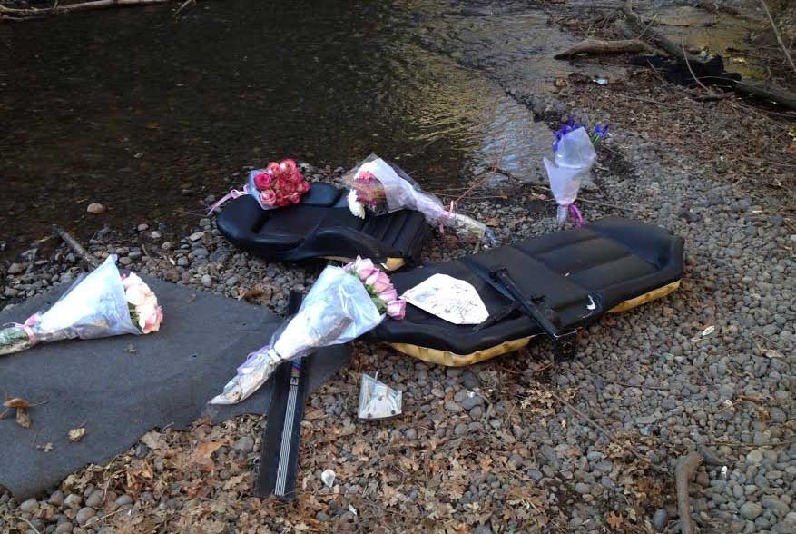 Flowers at the bottom of Big Chico Creek along Bidwell Avenue, where three Chico State students were involved in a single car crash Jan. 26 in the early morning. Orion File Photo.