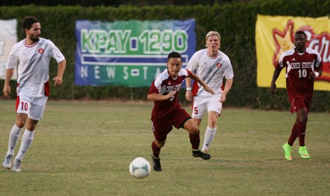 Freshman forward Patrick Lee sprints to the ball on September 12, 2014 at the Chico State Wildcat soccer field. Photo credit: John Domogma