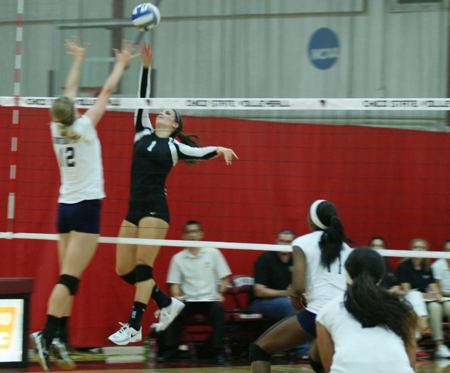 Chico State volleyball player Kristyn Casalino meets the opposition at the net. Photo credit: John Domogma