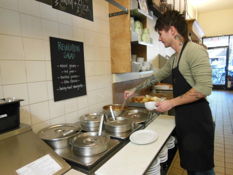 Alexander Madrid, a server at Upper Crust Bakery, pours some soup for a customer. Photo credit: Christina Saschin
