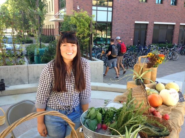 Elisabeth Quick, a senior agriculture major, manages the Organic Vegetable Project market , which is full of organic produce she hand-picked. Photo credit: Amanda Rhine